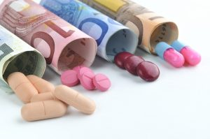 medical pills and tablets in euro bank notes money costs symbol