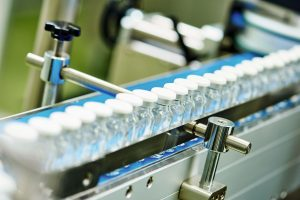 machine conveyor with glass bottles ampoules