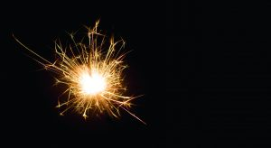 Bright sparks on deep black background closeup. Party holiday sp