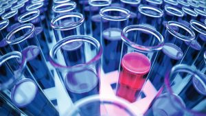 3D rendered blue laboratory test tubes with red positive results