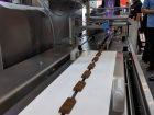 Bei Bosch gibt es ein neues Verpackungssystem zu sehen, mit dem sich Riegel, Kekse, Backwaren und weitere Produkte verpacken lassen. Halle 1, Stand 204
