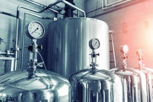 Manometers on steel cylinder storages or vats or tanks on juice