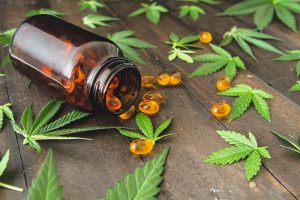 CDB oil capsules and hemp leaves