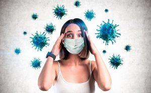 Scared woman in mask, coronavirus panic