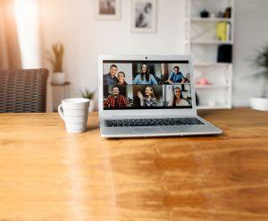Video meeting on laptop screen, zoom app