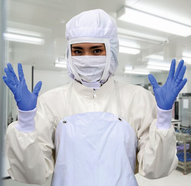 Lab worker in Protective Clothes and mask with gloves for doing